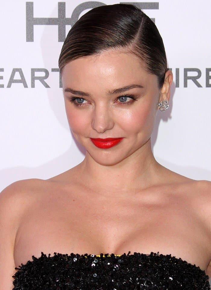 Miranda Kerr wears red lipstick and side-parted bun