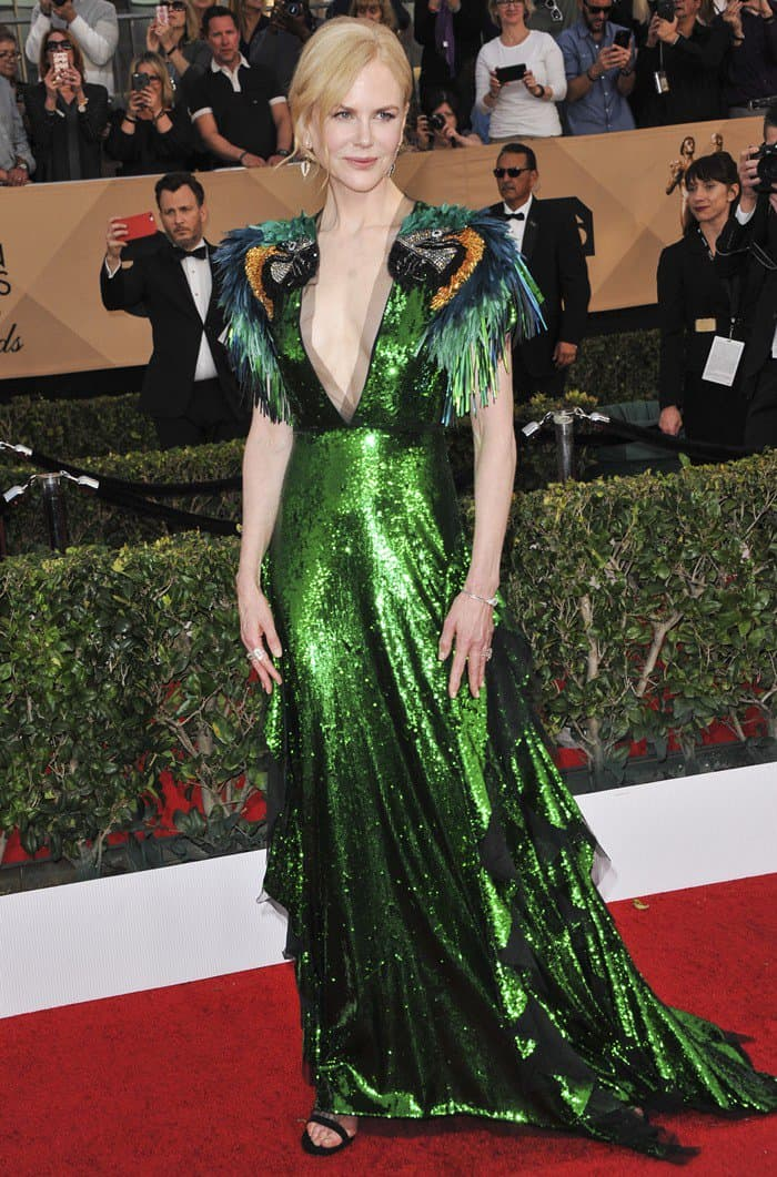 Nicole Kidman donned a playful Gucci dress featuring colorful beaded and feather parrot embroidered shoulders and a skirt with black tulle cascading ruffles