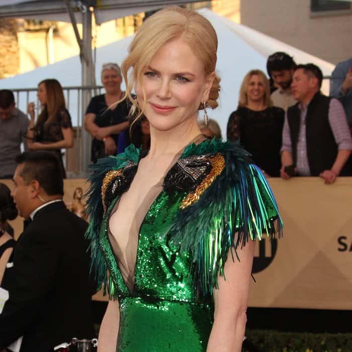 Nicole Kidman wearing a playful green parrot dress with a plunging neckline