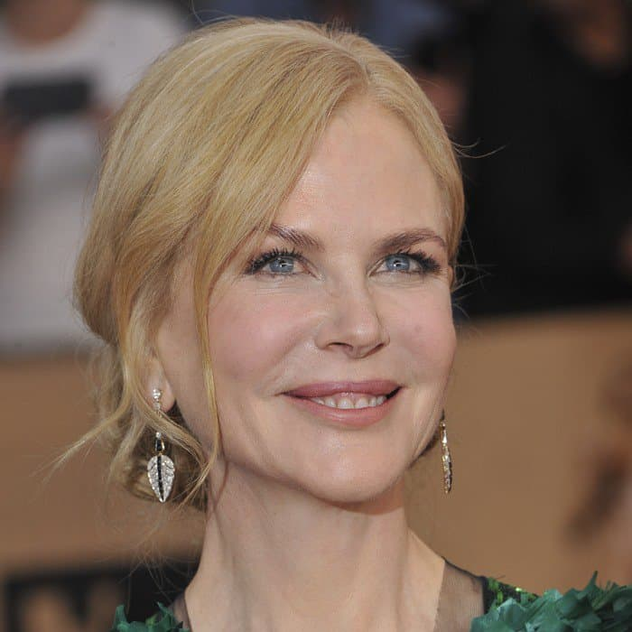 Nicole Kidman wearing a playful green gown with a plunging neckline