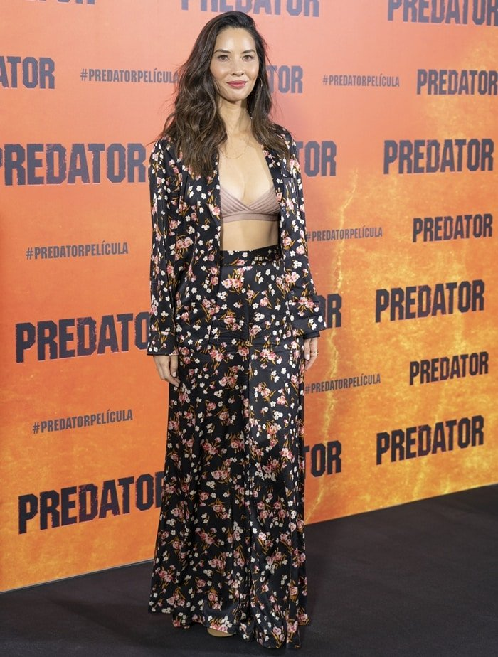 """Olivia Munn's nude Cherry sandals were barely visible underneath her A.L.C. """"Seton"""" pants in floral-print 25mm stretch satin"""