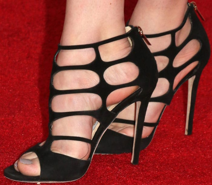 Peyton slips her feet into the sexy Jimmy Choo Ren sandals