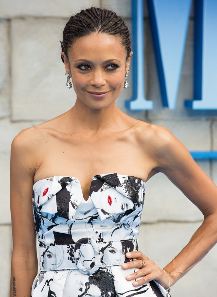 Thandie Newton wearing a white-and-black strapless Michael Kors Collection Fall 2018 portrait-print dress