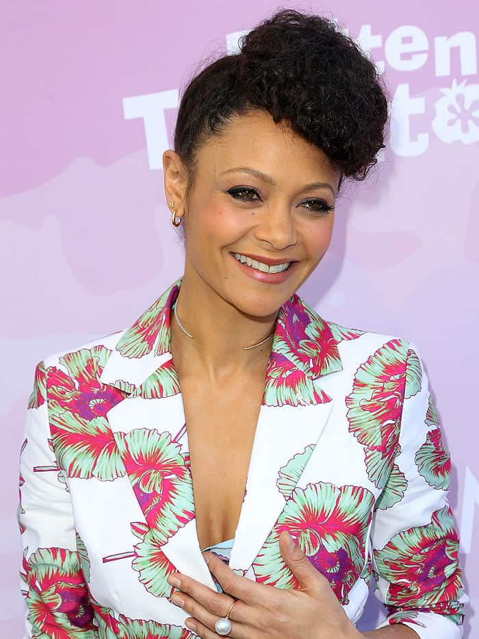 Thandie Newton wearing a floral-print jacket paired with a floral-print dress