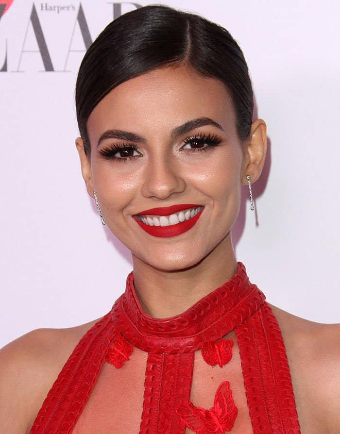 Victoria Justice in a side-parted bun and red lipstick