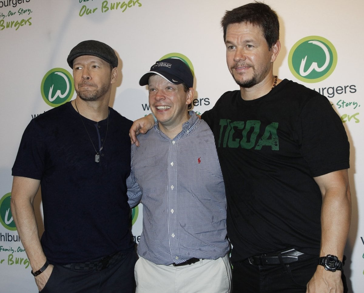 Wahlburgers is a casual dining burger restaurant and bar chain owned by chef Paul Wahlberg (C) and his brothers, actors Donnie Wahlberg and Mark Wahlberg