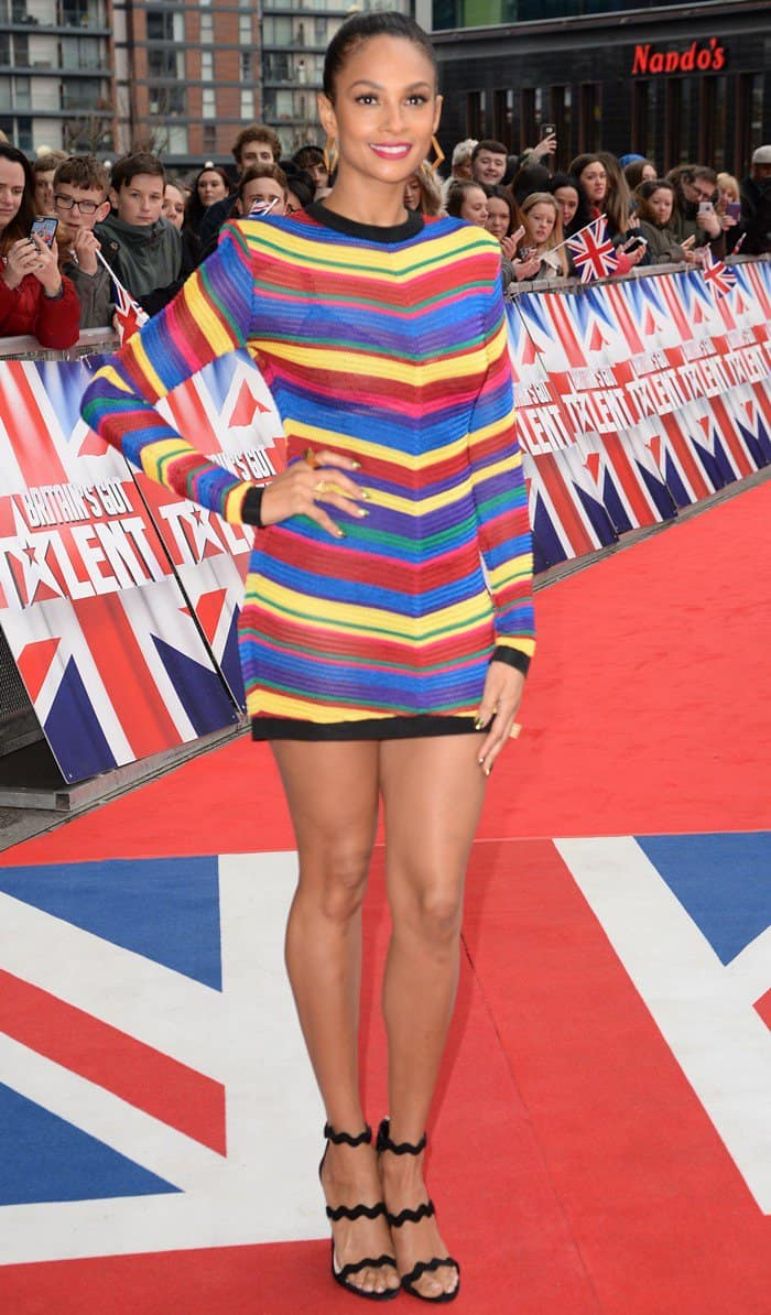 18a88b353ea Alesha Dixon showing off her famous pins in a multicolored mini-dress at  The Lowry Theatre in Manchester on February 9
