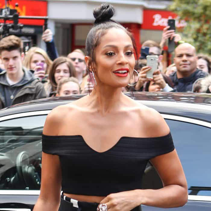 Alesha Dixon shows off her flat abs in a black Bardot top