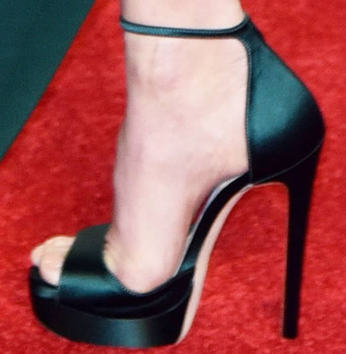 Amy hit the BAFTA red carpet in a pair of mossy green Jimmy Choo platform sandals