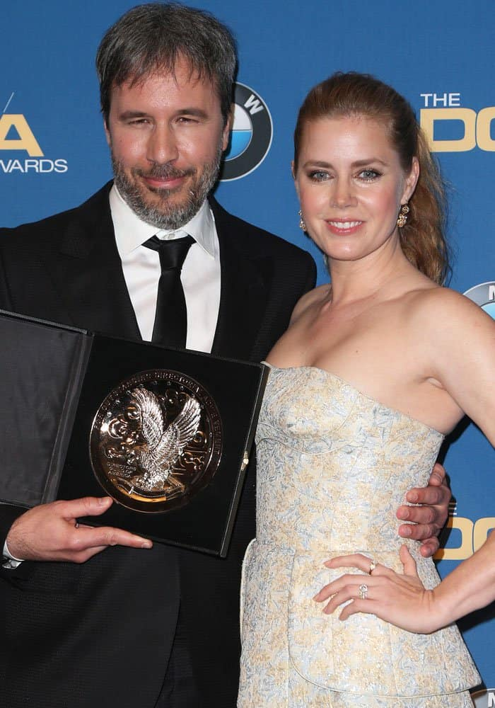 Amy poses with Arrival director Denis Villeneuve