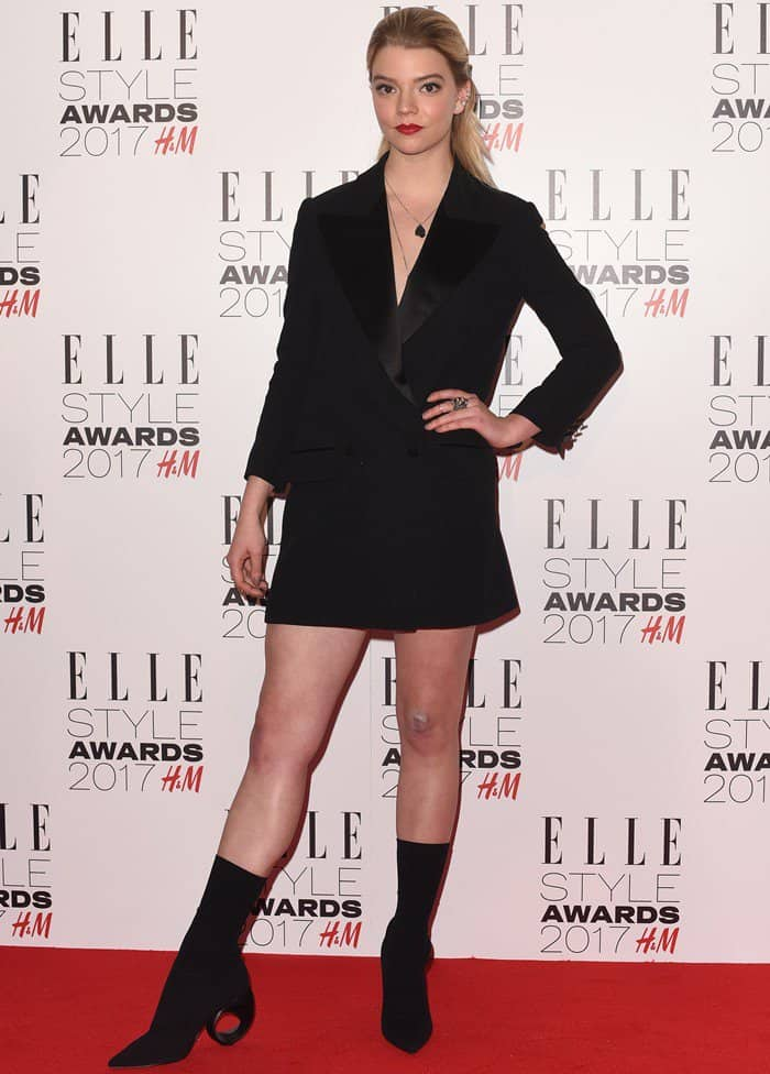 Anya Taylor-Joy wore a head-to-toe Burberry outfit consisting of a masculine tuxedo jacket and a pair of unique ankle boots. Her suede booties feature heels with circular cutouts
