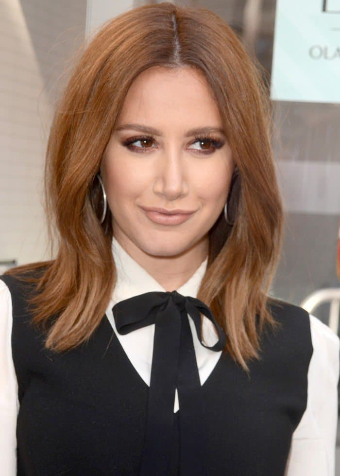 Ashley Tisdale looked cute in a fashionable mini dress as she smiled to photographers at Olay's DUO launch in Hollywood at the Highland Center in Hollywood on February 16, 2017