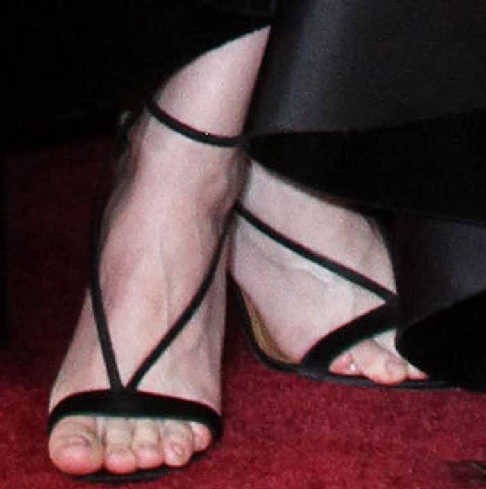 Brie puts on a sexy but subtle pair of custom Aquazzura Casanova sandals
