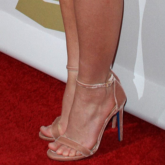 Britney showing off her feet in ankle-strap sandals