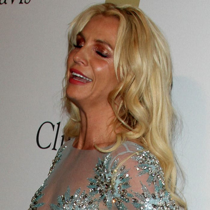 Britney Spears styled the daring long-sleeved dress with a deep scarlet eye shadow
