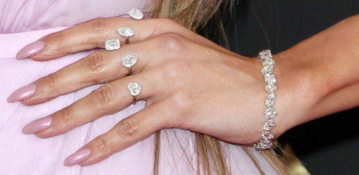JLO wearing a Butani diamond bracelet and rings