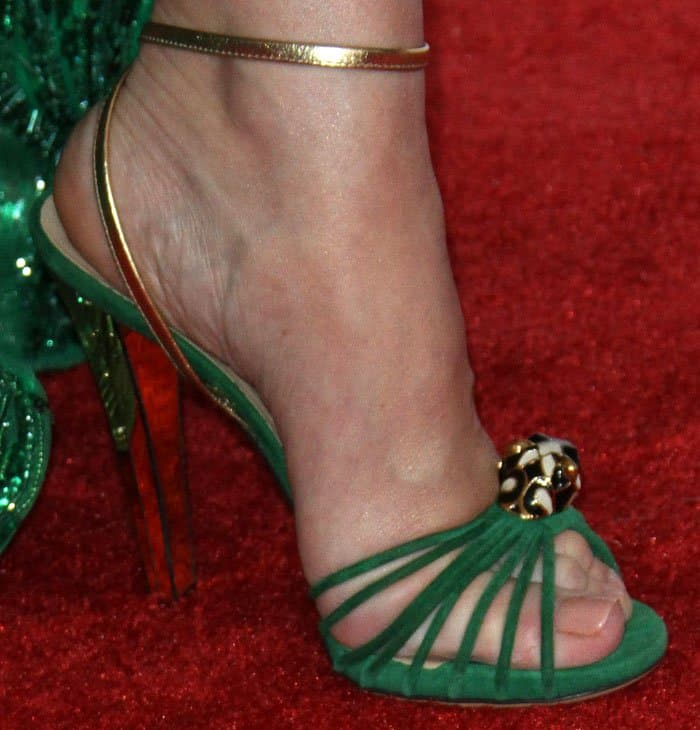 Celine goes green in a pair of Gucci strappy sandals