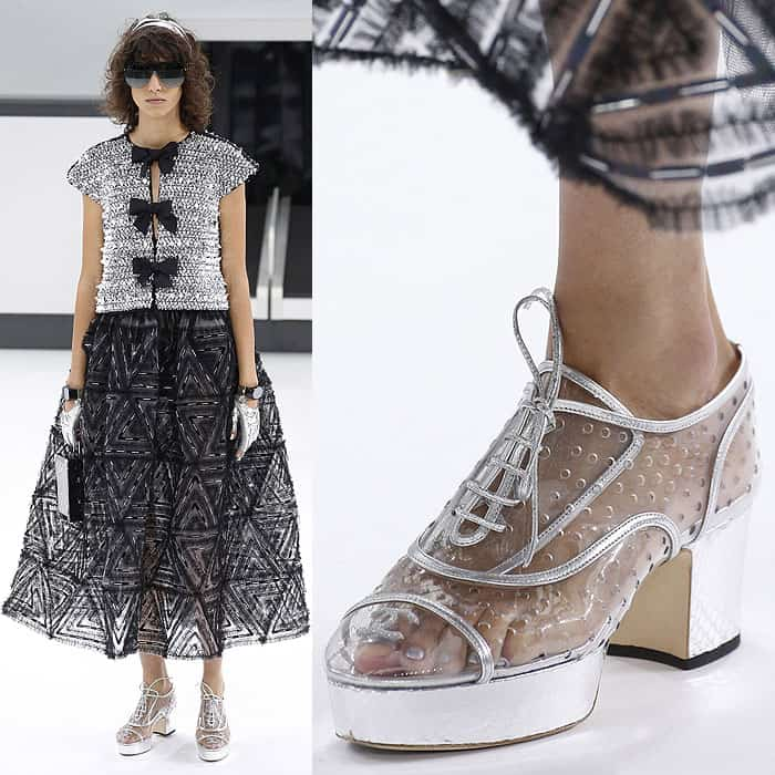 A model in holey clear shoes at the Chanel spring 2016 fashion show