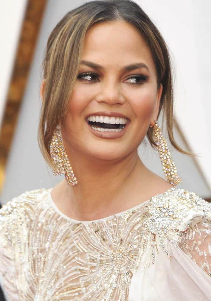 Chrissy Teigen shows off her jewelry from Lorraine Schwartz