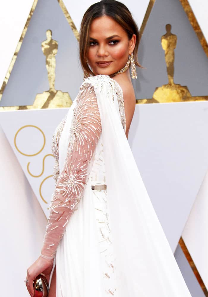Chrissy shows off the cape of her Zuhair Murad couture gown