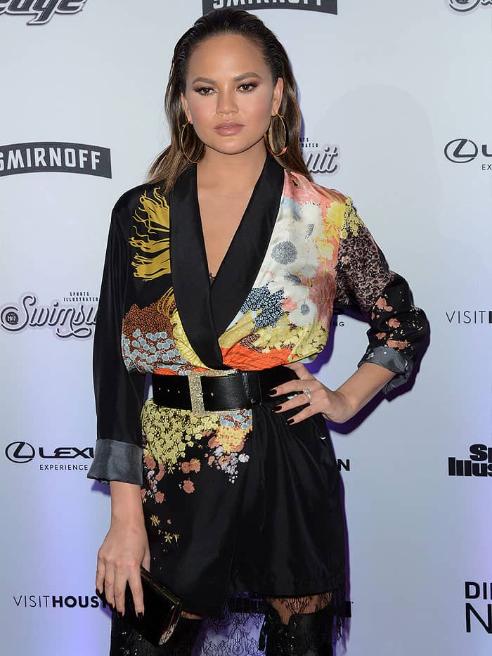 Chrissy Teigen appeared to wear only a satin robe to the event