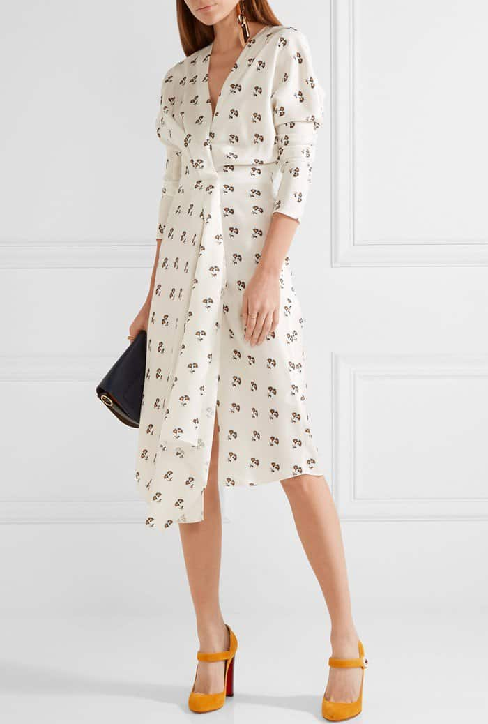 Model wearing a dress from Victoria Beckham that is printed with a pretty daisy motif