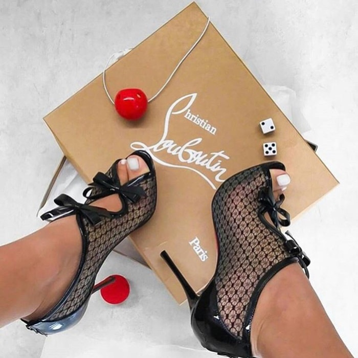 Christian Louboutin's 'Empiralta' sandals have been made in Italy from sheer mesh that's intricately embroidered to create the illusion of lace