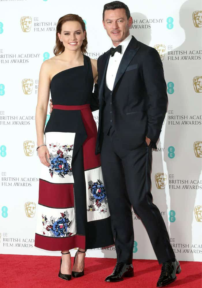 Daisy Ridley poses with her co-presenter Luke Evans