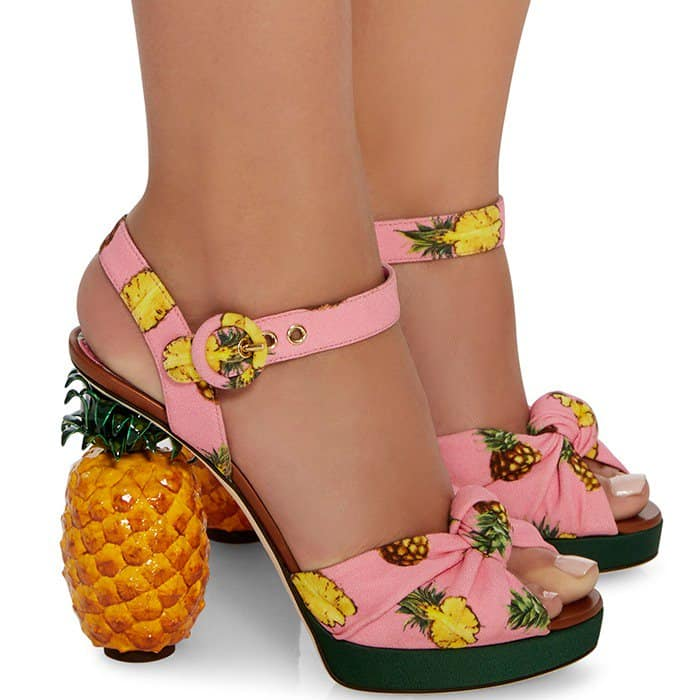 These multicolored pink crepe sandals are playfully decorated with pineapples and have a matching glossy acrylic heel