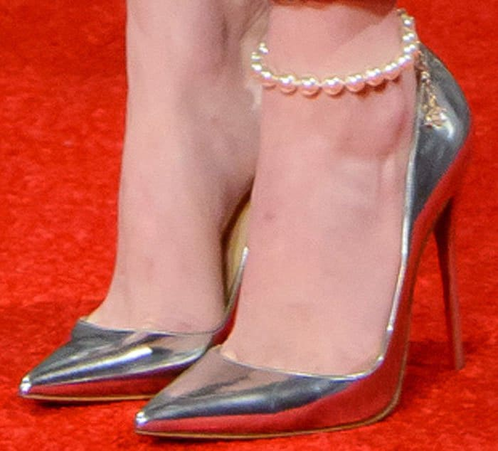 Emma shines in a pair of metallic silver Christian Louboutin So Kate pumps