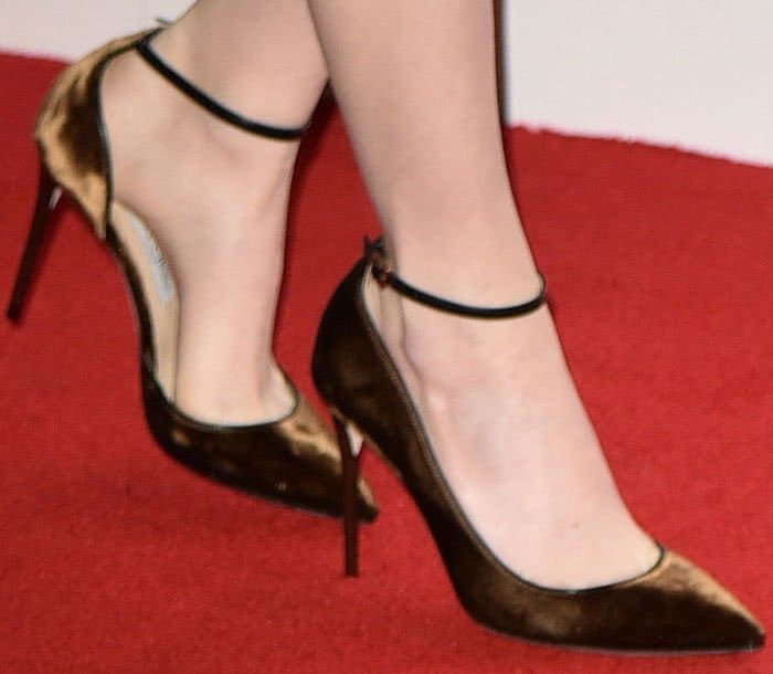 Emma switched out her typical black pumps for a pair of bronze suede Jimmy Choo