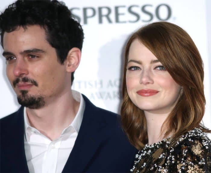 Emma poses with director Damien Chazelle