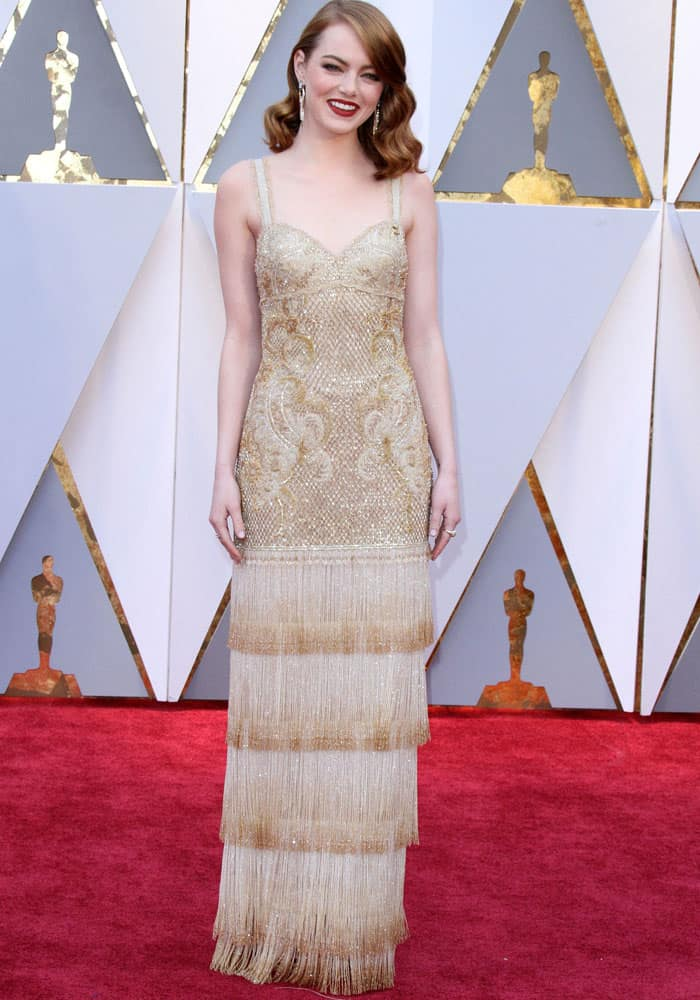 Emma shines in a Givenchy dress