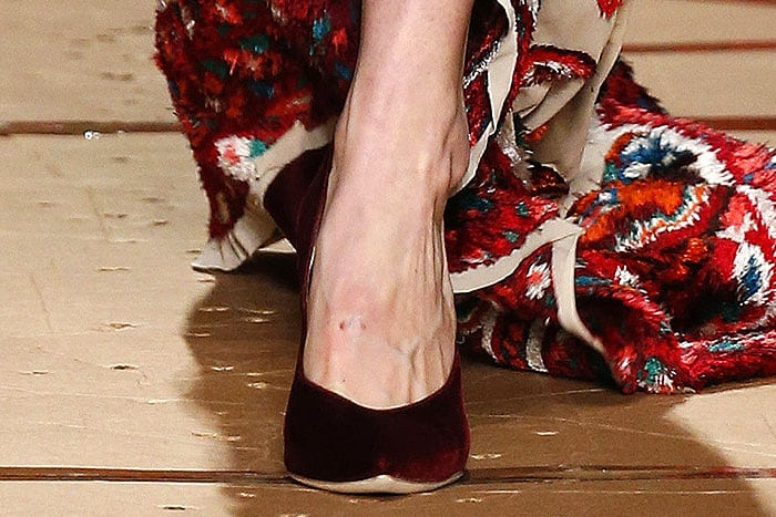 Red velvet pumps on Gigi Hadid