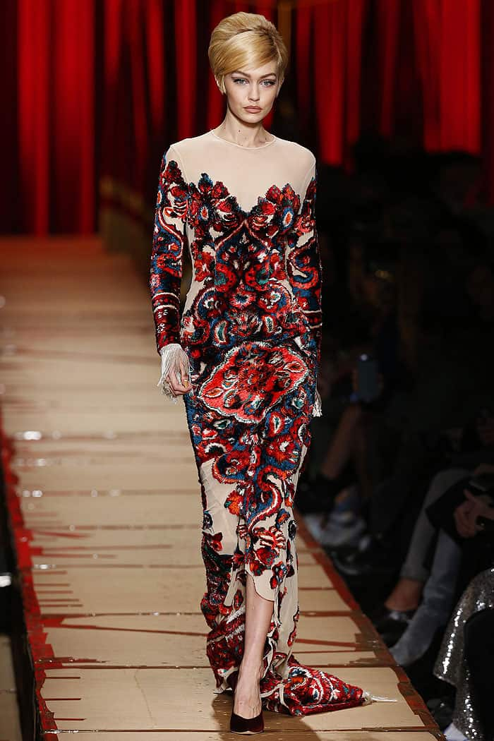Gigi Hadid in a carpet-like gown at the Moschino fall 2017 fashion show