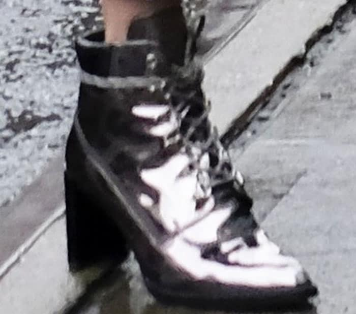 Gigi wears her namesake Stuart Weitzman Gigi boots in metallic leather