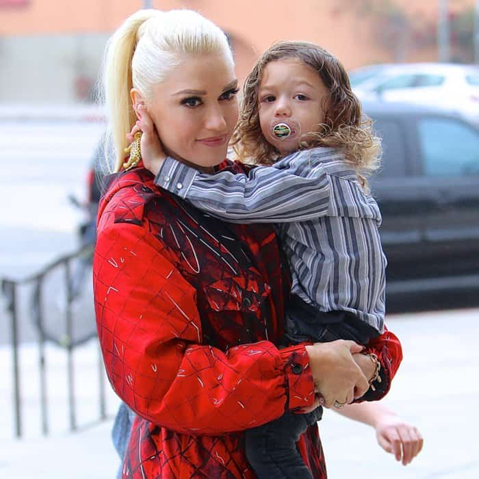 Gwen Stefani carries her son, Apollo Bowie Flynn Rossdale