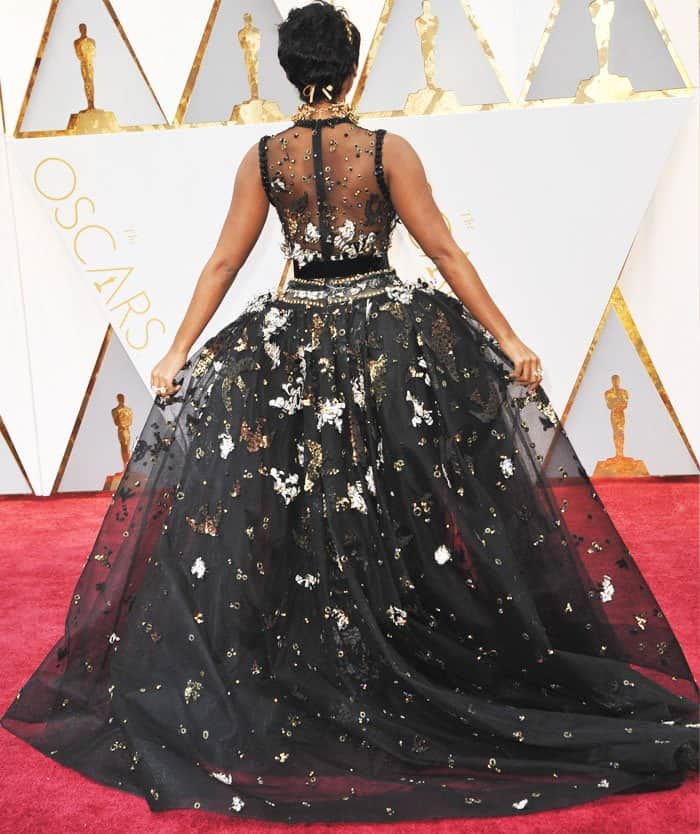 The singer-actress shows off the back view of her gorgeous Elie Saab dress
