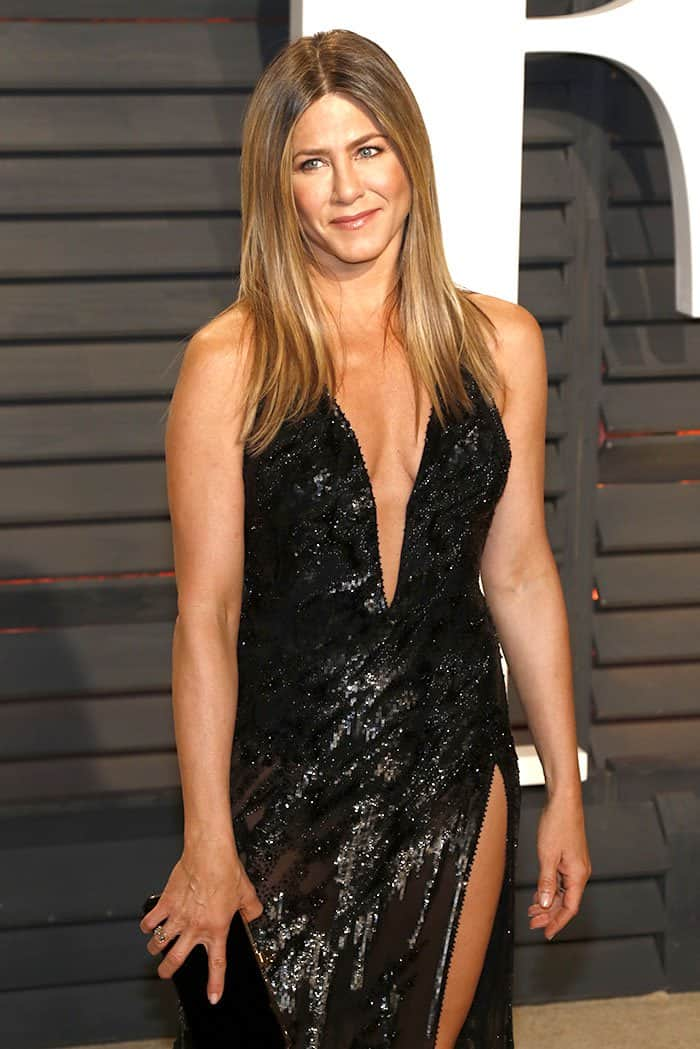 Jennifer Aniston gave female celebrities half her age a run for their money in a daringly-cut Atelier Versace gown