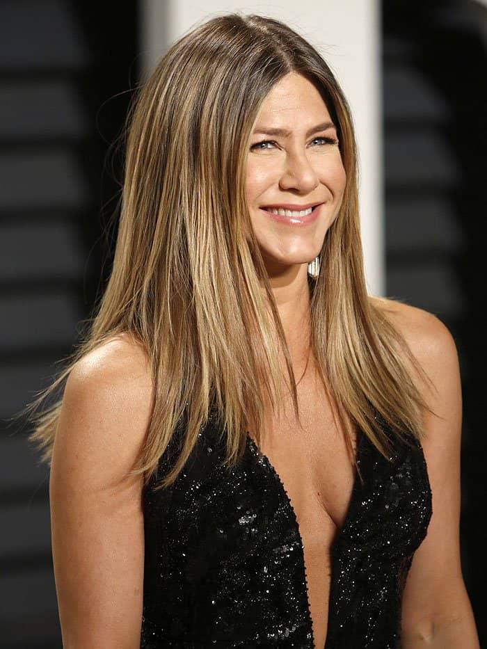 Jennifer Aniston reveals side-boob in a black Atelier Versace dress