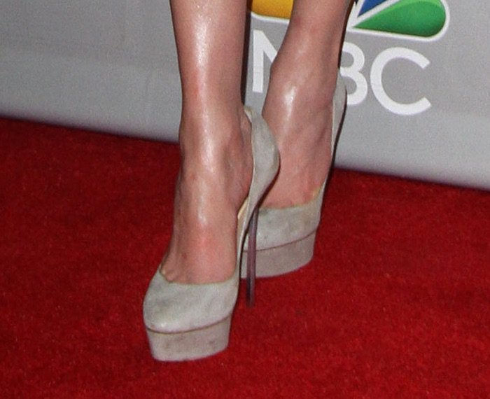 Jennifer Lopez paired her outfit with grey platform pumps