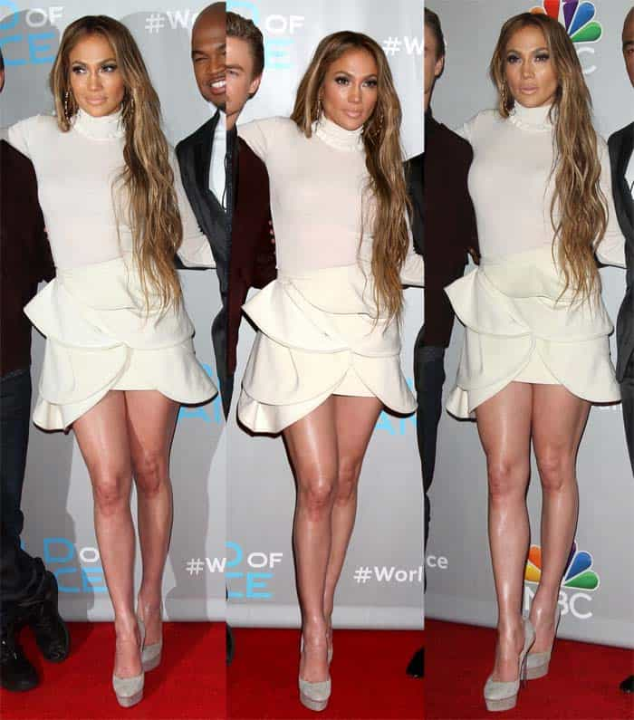Jennifer Lopez glowed in a white long sleeved top and mini skirt