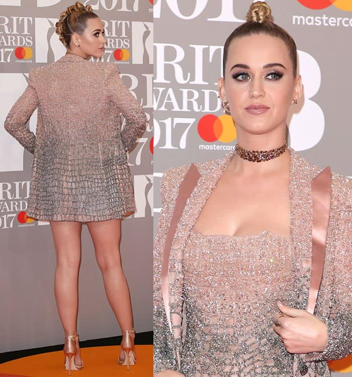 Katy Perry showed a hint of cleavage in an ombre mini dress with a fringed hem