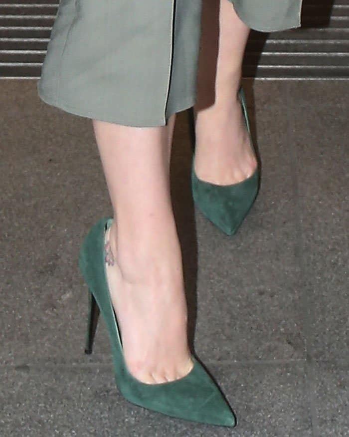 Katy Perry wearing an Elisabetta Franchi blazer and culottes, a Vanessa Seward turtleneck top, and green suede pumps