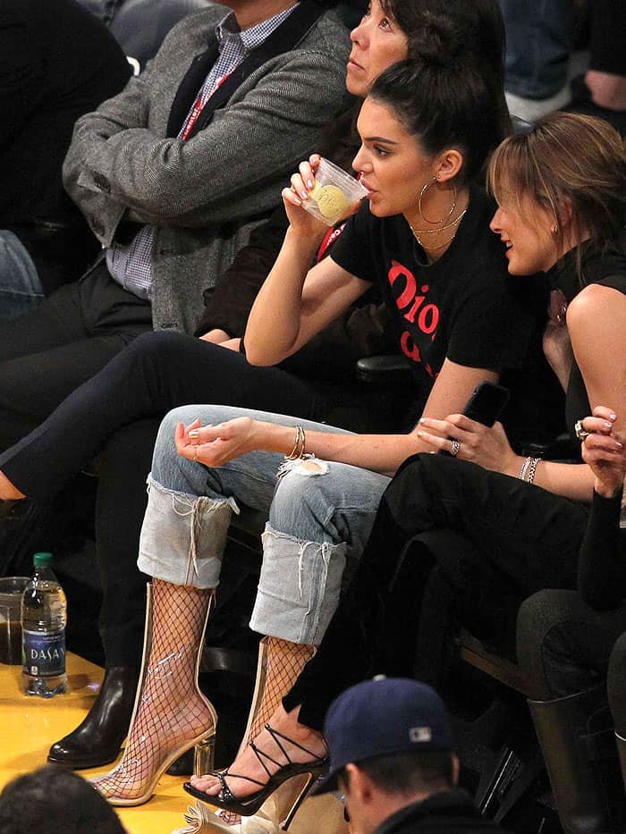 Kendall Jenner wearing fishnets with clear Yeezy boots