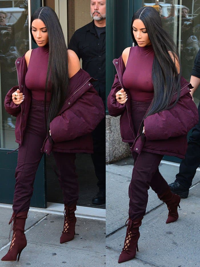 Kim Kardashian completed her look with high-waist sweatpants and favorite lace-up boot style