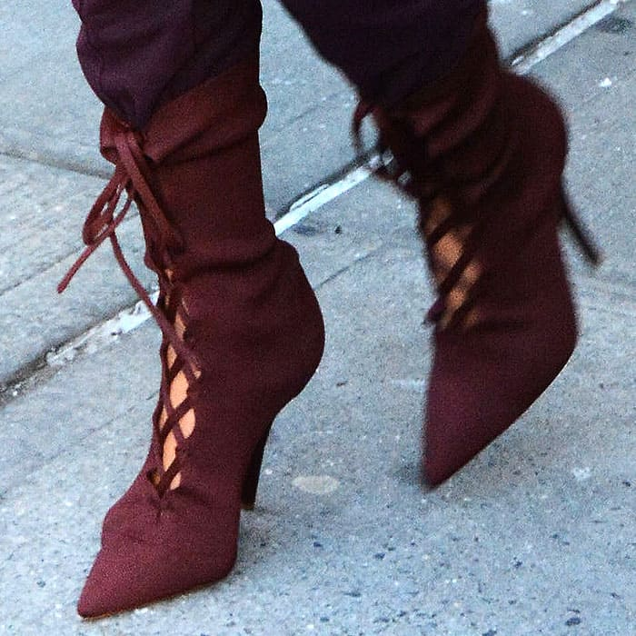 Kim Kardashian in Burgundy Yeezy Lace-Up Boots