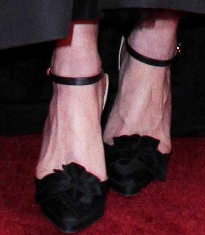 Kirsten wears a pair of Christian Lacroix pumps