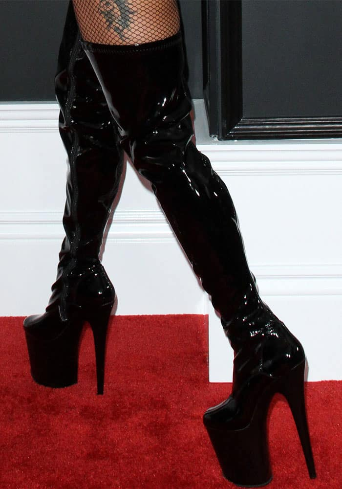 "A pair of Pleaser USA's ""Flamingo 3000"" platform patent boots finished Gaga's Grammy look"