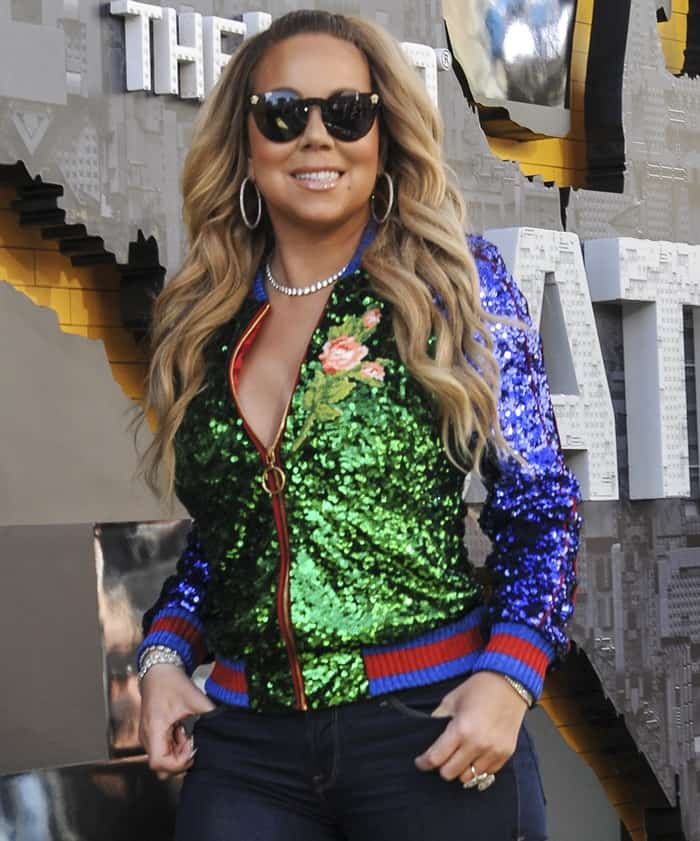 Mariah Carey rocking a Gucci appliquéd sequined tulle and satin bomber jacket